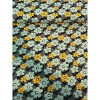 Jersey med mint og gul blomster på grå bunn