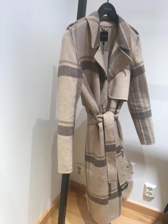 Tana Coat Check