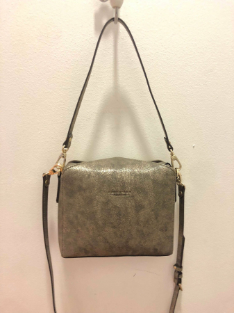 Synthetic patent convertible clutch