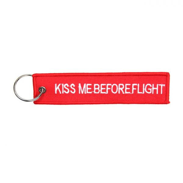 KISS ME BEFORE FLIGHT KEYCHAIN RED