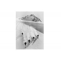Five men skiing downhill