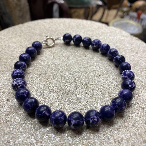 Armbånd m. lilla perler