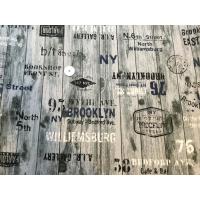 Kraftig bomullstoff skrift på grå vegg